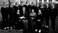 Castleisland Day Care Centre became the favourite charity of the area in the early 2000s. Here, students from St. Joseph's Presentation Girls' Secondary School present a cheque for €560 towards the provision of a bus for the centre. Karen Brosnan presented the cheque to Monica Prendiville who represented the centre. Included are; teacher, Mairéad O'Mahony and Tina Glover. Back row from left: Tara Brosnan, Mary Thea Brosnan, Ann-Marie Templeman, Thecla O'Connor, Sinéad Murphy, Aoife McCarthy, Karen Flynn, Aisling O'Sullivan, Catheriona White and Marguerite Callaghan. ©Photograph: John Reidy 17-1-2002