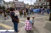 Applause from the flags and appreciation from the street at the Coiste Na nÓg 50th anniversary parade in Castleisland on Sunday. ©Photograph: John Reidy