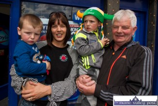 Aisling Barrett and her boys, Ronan and Jay and her dad, Mike Geaney watching the Coiste Na nÓg 50th anniversary parade in Castleisland on Sunday. ©Photograph: John Reidy