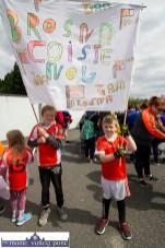 Brosna boys, Joel Smith and Josh Lane hoist their colours at the Coiste Na nÓg 50th anniversary parade in Castleisland on Sunday. ©Photograph: john Reidy