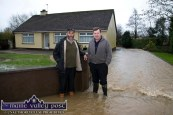 Danny Healy Rae, TD with Seán Hickey outside his house as flood waters take a short-cut through his property to the nearest river. ©Photograph: John Reidy 24-1-2014