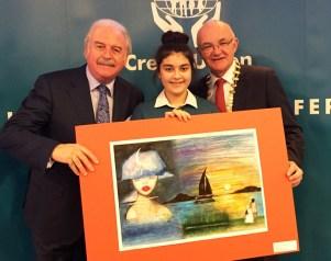 2016 U-11 winner Eileen Novac, Mercy Mounthawk, Tralee with MC Marty Whelan and Brian McCrory, President of the Irish League of Credit Unions.