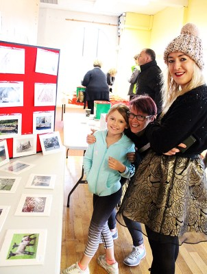 Kate McSweeney (right) pictured with Tara Walmsley and her little girl, Cliona at the Castleisland Camera Club Charity Exhibition and Sale of Work at The Market House on Saturday. Photograph: Castleisland Camera Club.
