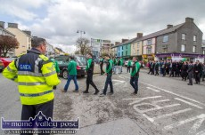 Sgt. John O'Mahony removes his cap in a salute to a good friend and 'a sound man' as the remains of Georgie O'Callaghan are shouldered onto Main Street in Castleisland on Thursday morning. ©Photograph: John Reidy