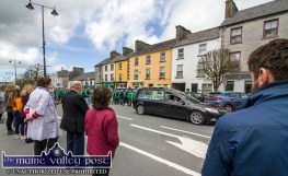 Shopkeepers and customers take time out to pay their respects to the late Georgie O'Callaghan as his remains are being take through Castleisland to Kilbanivane on Thursday afternoon. ©Photograph: John Reidy