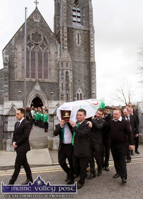 Georgie O'Callaghan's remains being led by his nephew, Thomas Brosnan and shouldered from the Church of Saints Stephen and John in Castleisland on Thursday afternoon by Castleisland AFC members: Paul Geaney, Mike Brosnan, Patrick O'Rourke and Dan Maunsell with Georgie's nephews, Joe and Denis Sugrue to the right. ©Photograph: John Reidy