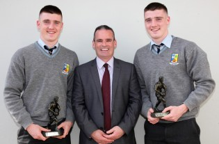 Principal, Denis O'Donovan pictured with Sixth Year Sports Award winners, Eddie and Seán Horan.