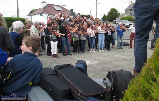 Hard cases: Fiddles freed, cases abandoned in Scartaglin as the annual photograph and tunes session gets underway at World Fiddle Day Scartaglin 2018 on Saturday afternoon. ©Photograph: John Reidy