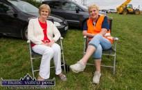 Phil Carmody, Ballymacelligott (left) and Martina O'Mahony keeping an eye on the sideshows at Castleisland Races on Sunday afternoon. ©Photograph: John Reidy