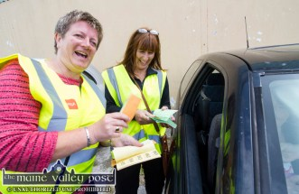 Drive-In Bingo volunteers, Betty O'Connell and Siobhán Hayes selling raffle tickets during Sunday's session at Castleisland Co-Op Mart. ©Photograph: John Reidy