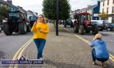 Different Perspectives: These two snappers are attracted by different sides of the annual Paudie Fitzmaurice Memorial Charity Tractor Run. ©Photograph: John Reidy 9-9-2018