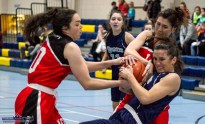 Tough work: A tough struggle for possession between Phoenix Rockets' captain Rebecca Barker and Team Tom McCarthy's Maebh Barry and captain, Lorraine Scanlon during Saturday night's game in Castleisland. ©Photograph: John Reidy