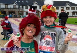 Two for the tree: Michelle O'Keeffe with her daughter, Isabelle from Millstreet with their Christmas tree medals after the Run Rudolph Run 5K event at An Ríocht Athletic Club in Castleisland. ©Photograph: John Reidy