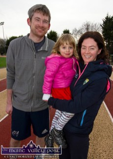 Little Mai Doherty pictured with Castleisland Macra members, Christine Buckley and Maurice Roche at the annual GOAL Mile at An Ríocht AC in Castleisland on Christmas morning. ©Photograph: John Reidy