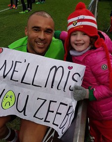 Hanna with her hero 'Zeebs' after one of his final games at Thomond Park.