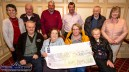 Martina O'Donoghue accepting a cheque for €1,000 on behalf of Castleisland Day Care Centre from members of the River Island Hotel 31 Card Players. Included are: Micheál McElligott, Hannah Hickey, Martina O'Donoghue and Mary McCarthy. Back from left: Tess Brosnan, Denis Geaney, Dermot O'Donoghue, Donie Cremins, Thomas Brennan and Marian Prendiville. ©Photograph:John Reidy