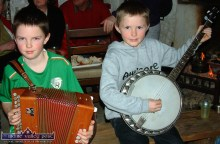 Brothers, Stephen (9) and Jason Foley (7) from Lisselton playing at the Tig Aggie Rambling House in Knockbrack, Knocknagoshel on a Friday night in February 2005. ©Photograph: John Reidy 5-2-2005