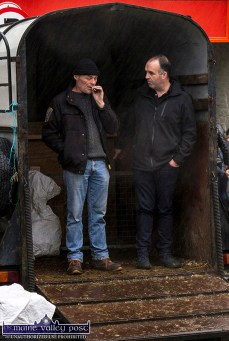 Any port in a storm as these men conduct their bit of business in a horse box at Friday's annual November 1st Horse Fair Day in Castleisland. ©Photograph: John Reidy