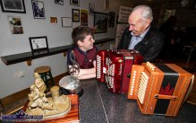 John Walsh, Newmarket passes on his Mol an Óige to Michael Healy, Kilcummin on his wins at the All-Ireland Fleadh Cheoil earlier this year when they met at the opening night of the 2019 series of Handed Down at Scartaglin Heritage Centre. ©Photograph: John Reidy 19-10-2019