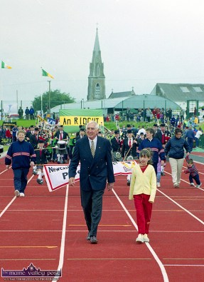 Niamh McSweeney from Currow accompanied Ireland's 1956 Olympic Gold Medal hero, Ronnie Delaney on a lap of the new track on the day of the official opening of An Riocht Athletic Club's facilities in Castleisland. ©Photograph: John Reidy 11-6-2000