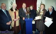 Miniature replicas of the bust of Nora Herlihy were presented to her sisters by John Hume MP. MEP at the opening of the museum in her honour in Ballydesmond in November 2000. Included are: Tadhg O'Carroll, Kathleen Matthews - a fellow Credit Union movement pioneer and friend of Nora Herlihy, Mr. Hume and Ms. Herlihy's sisters: Sheila O'Carroll, Margaret Murphy and Sr. Dorothy. ©Photograph: John Reidy 27-11-2000
