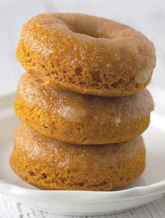 3 stacked doughnuts on white plate