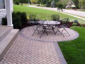 Backyard Patio Landscaping job in Prosper, TX with outdoor seating area, concrete and paver hardscapes, shrubs and new sod.