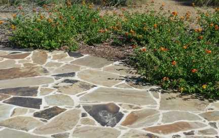 Flagstone patio installation over concrete