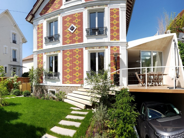 Une extension moderne en bton pour agrandir une maison bourgeoise