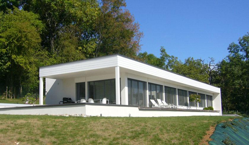 Maison contemporaine terrain en pente  Brulet architecte