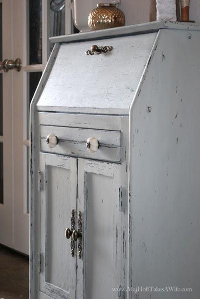 White knobs on sugar cane blue green secretary desk