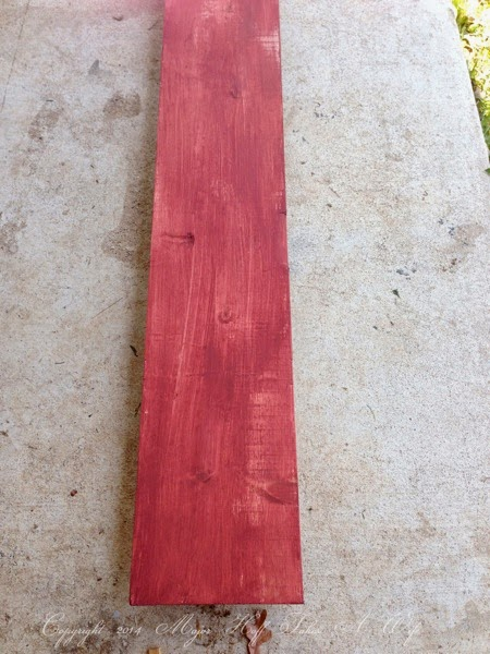 Lightly paint a plank of wood