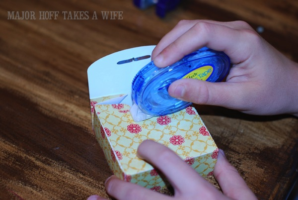 Apply tape to hold scrapbook paper box together