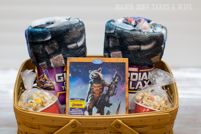 Guardians of the Galaxy movie basket with movie munch. It's time for a Family Movie Night! You won't want to miss this recipe for the fabulous Movie Munch! Can you guess what the secret ingredient is? Post also shows how to create your own Guardians of the Galaxy Gift Basket, perfect for your favorite super hero fans, or for a Finals Survival kit. #OwnTheGalaxy #CBias #sp #ad
