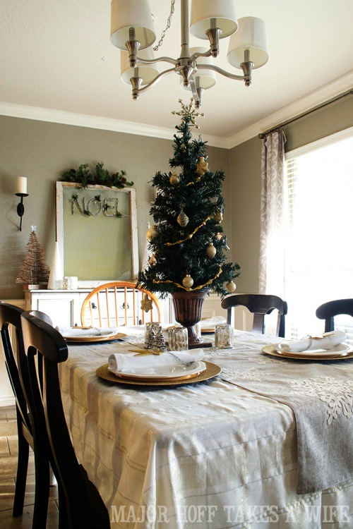 Restoration Hardware Christmas Tree as a table centerpiece. A delightful Dining Room Holiday Tour. See how Mrs Major Hoff decorates for Christmas. The tour features table decorations, dining room decorating ideas, place settings and an idea for  homemade Christmas gift that can be personalized for your holiday guests. This post is part of the Home For The Holidays Blog Tour.