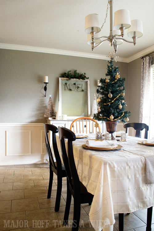 Silver and Gold Tablescape for Christmas. A delightful Dining Room Holiday Tour. See how Mrs Major Hoff decorates for Christmas. The tour features table decorations, dining room decorating ideas, place settings and an idea for  homemade Christmas gift that can be personalized for your holiday guests. This post is part of the Home For The Holidays Blog Tour.