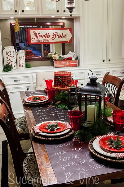 Vintage plaid tinware and North Pole inspired accents in the dining room.