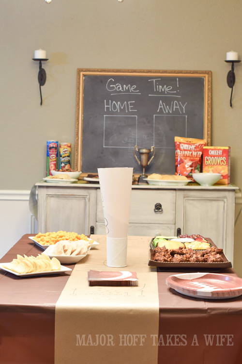Easy set up for a football Big game party. An easy to throw party for the Big Game. Features easy party ideas for snacks, dips and decor. Includes a recipe for Roasted Red Pepper Hummus without seeds! #BigGameSnacks #collectiveBias #ad