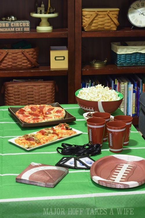 Football video game party. Looking for a fun party for your teenage boy? Why not throw a Football video game party? Easy ideas for how to entertain kiddos during the Big Game. Features DiGiorno pizza, personalized football cups, free printable lanyards, and an incredible recipe for football shaped ice cream sandwiches! #GameTimeMVP #CollectiveBias #ad