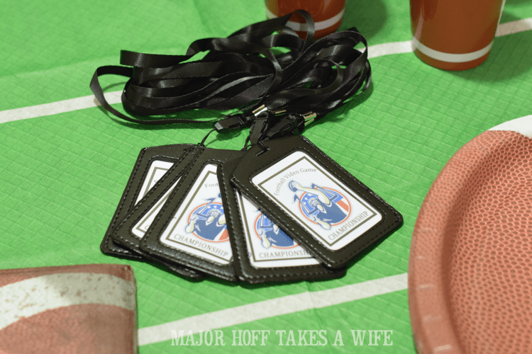 Lanyards make for a fun swag idea for a party. Looking for a fun party for your teenage boy? Why not throw a Football video game party? Easy ideas for how to entertain kiddos during the Big Game. Features DiGiorno pizza, personalized football cups, free printable lanyards, and an incredible recipe for football shaped ice cream sandwiches! #GameTimeMVP #CollectiveBias #ad
