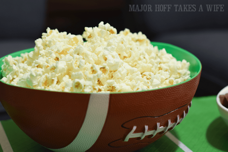 serve popcorn in a football bowl for a fun snack. Looking for a fun party for your teenage boy? Why not throw a Football video game party? Easy ideas for how to entertain kiddos during the Big Game. Features DiGiorno pizza, personalized football cups, free printable lanyards, and an incredible recipe for football shaped ice cream sandwiches! #GameTimeMVP #CollectiveBias #ad