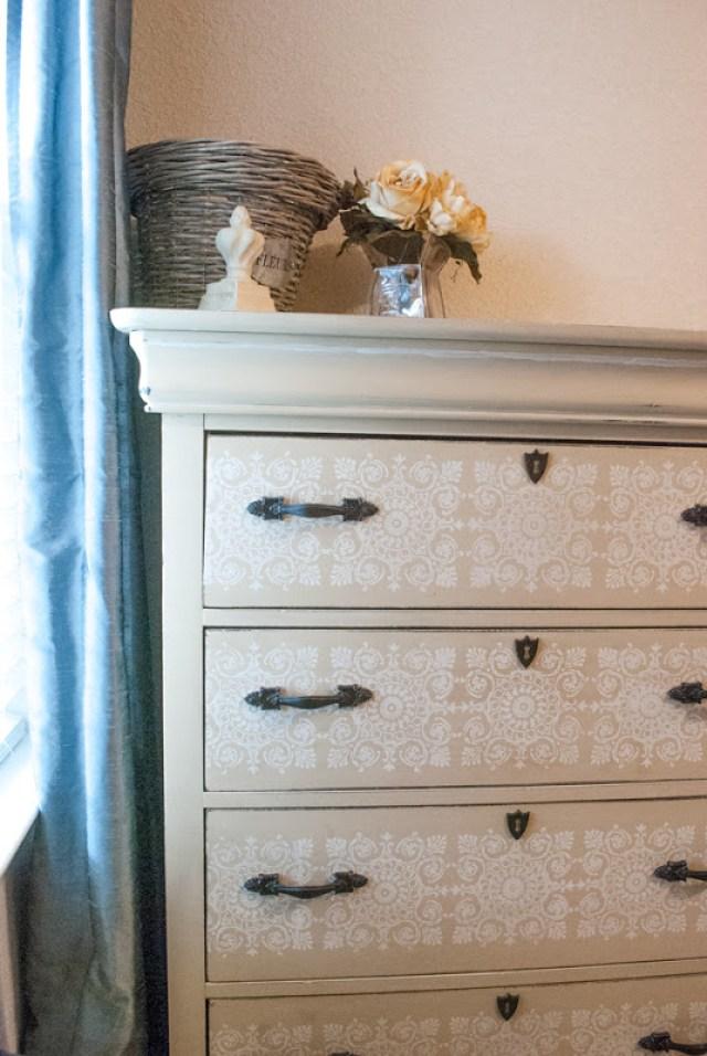Dark hardware on light painted dresser
