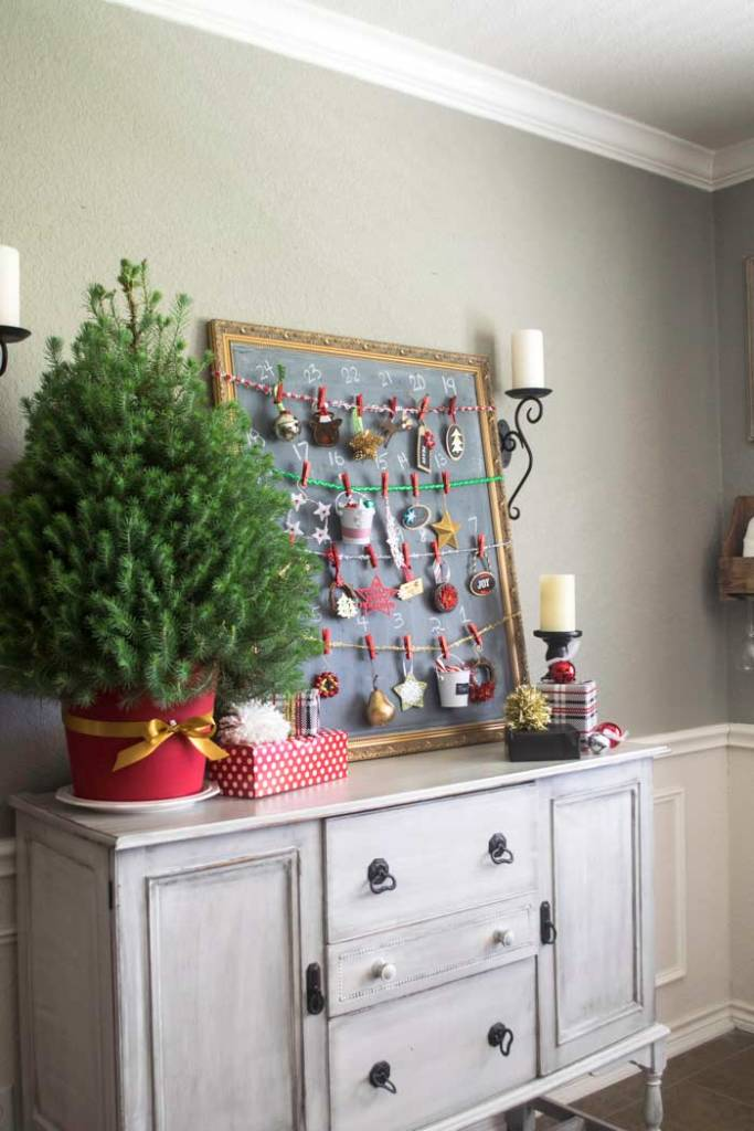 Dining room decorated for Christmas with a table top Christmas tree advent calendar on a buffet side table