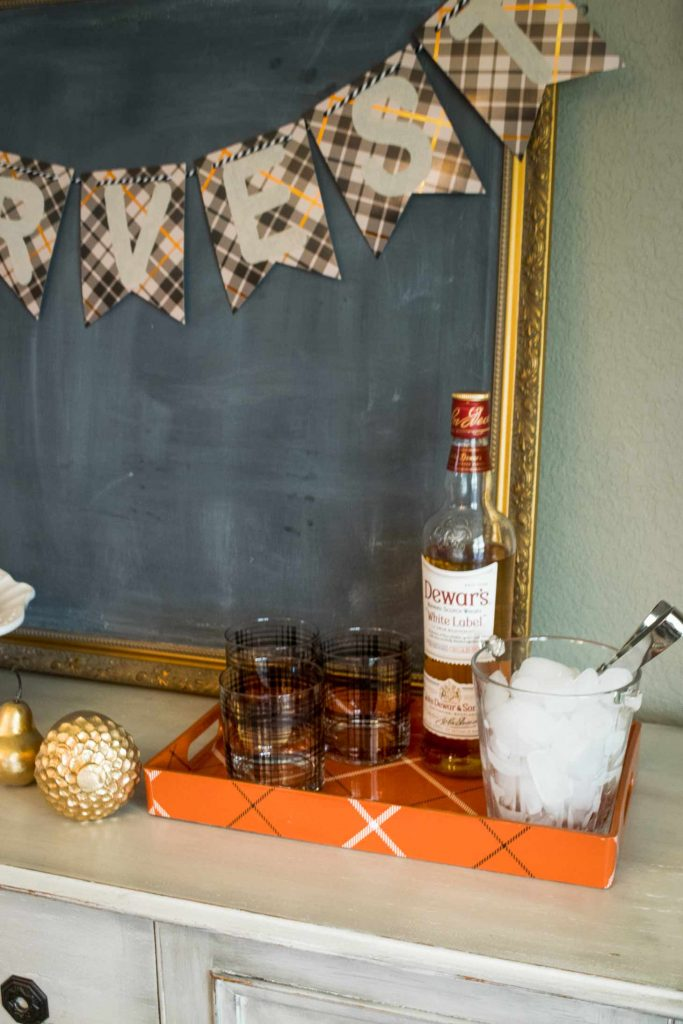 whiskey glasses with Dewars scotch and a vintage glass ice holder for a golden thanksgiving set up