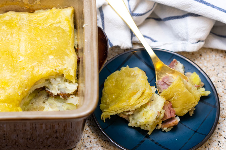 a casserole dish with ham cheese and potato pie casserole