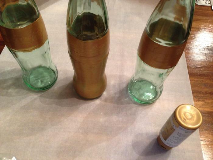 Gold paint coke bottles