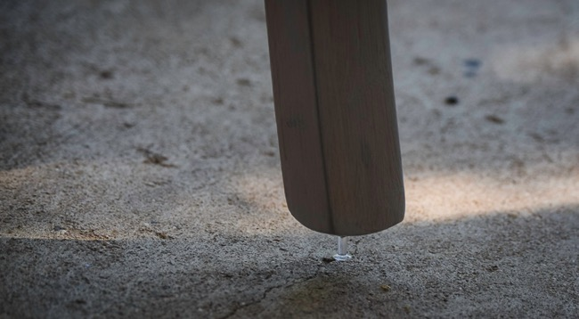 Using a thumbtack to paint furniture feet