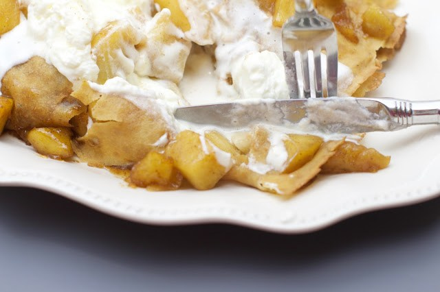 caramelized apple crepes loaded with whipped cream