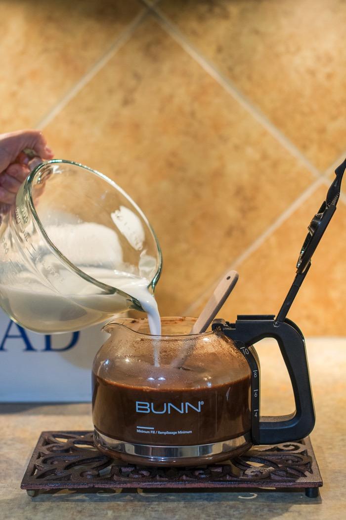 Warm milk to coffee with mocha mix