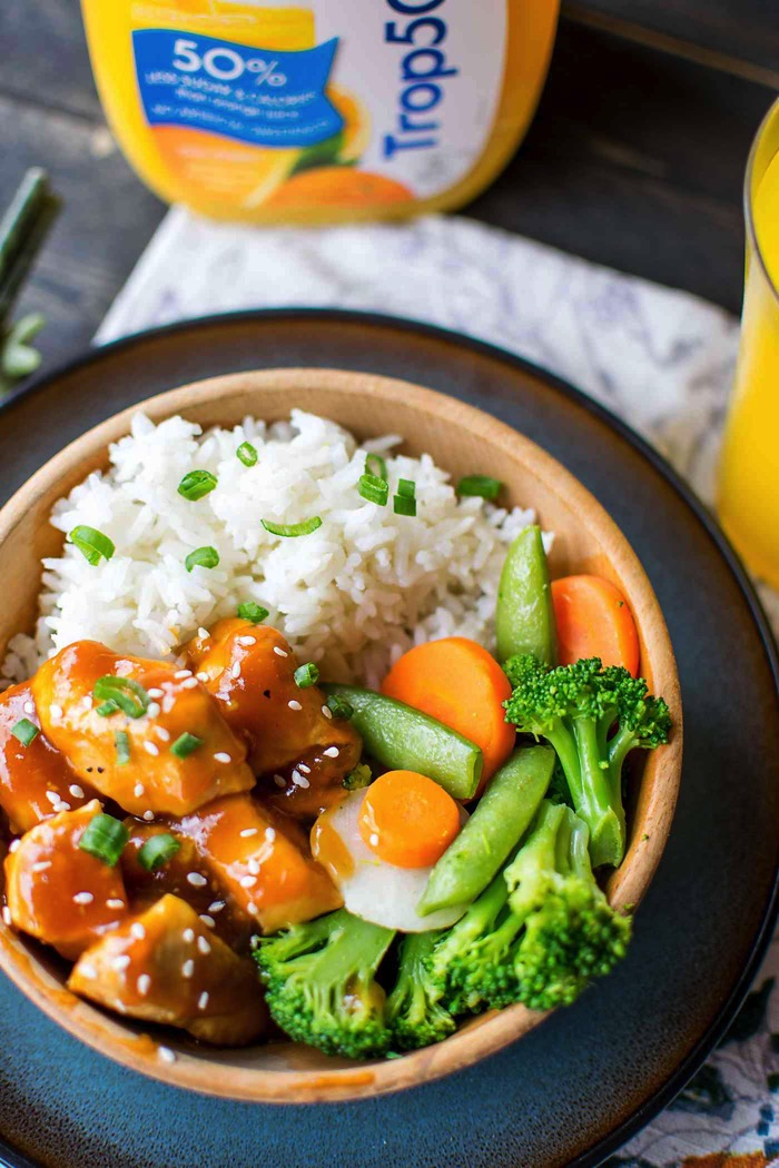 healthy orange chicken with rice and veggies for lunch